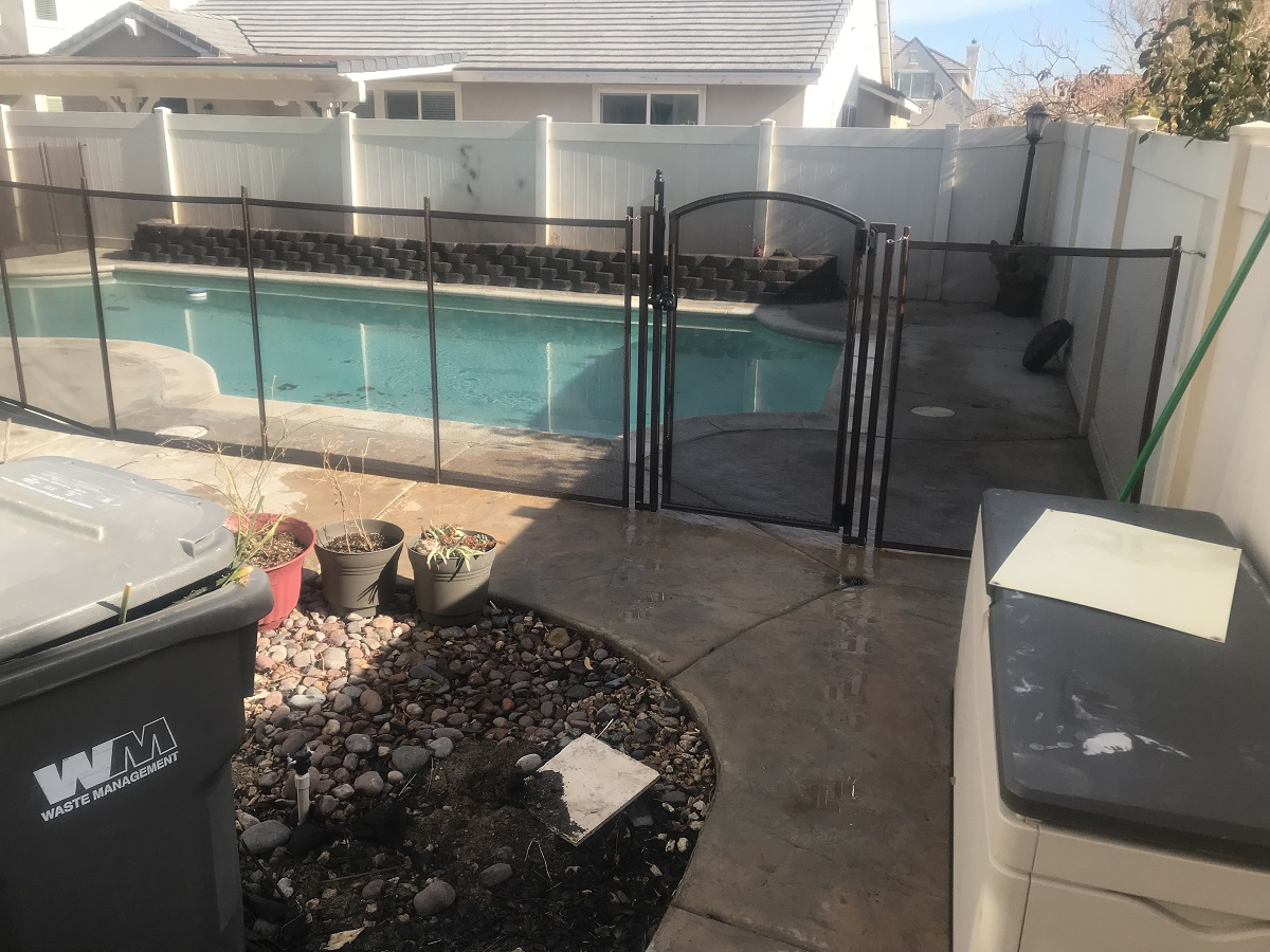 black pool fencing installed in a Palmdale, CA home