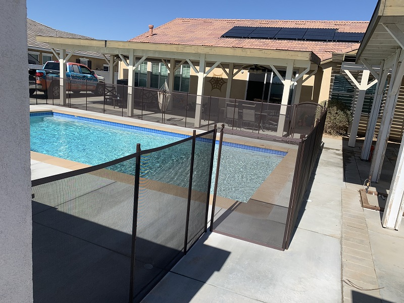 brown mesh pool fence installed in Lancaster, CA