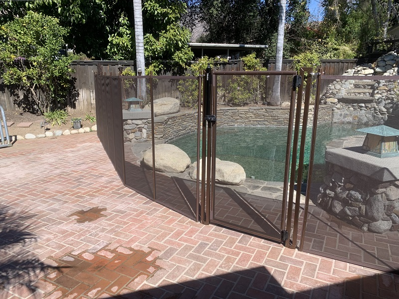 brown mesh pool fence installed in Monrovia, CA