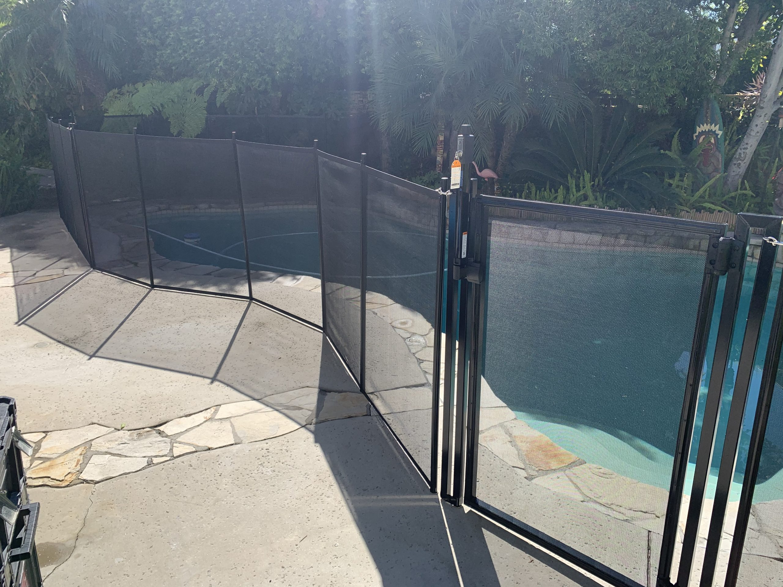 mesh pool fence installation in Long Beach, CA by King's Pool Fencing